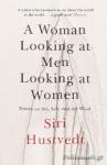 (P/B) A WOMAN LOOKING AT MEN LOOKING AT WOMEN