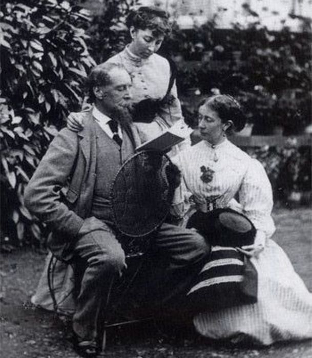Dikens Reading to his daughters